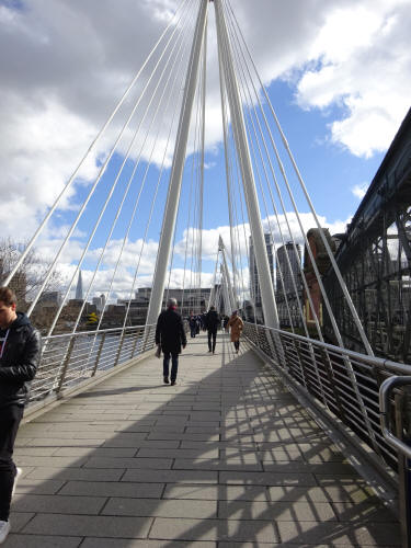 Golden cross bridge, a pedestrian walkway, and looking across the River Thames, in March 2020